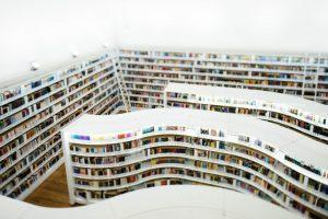 White curved bookshelves.