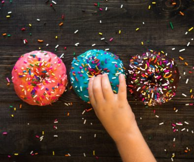 Child chooses a donut with sprinkles!