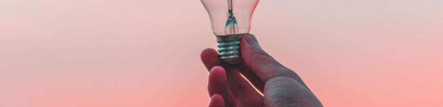 Person holding a lightbulb.
